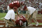 Alabama trainers work on Tyrone Prothro as quarterback Brodie Croyle pats him on the back after he broke his leg on a incomplete pass-play in the fourth quarter of their 31-3 win over Florida at Bryant-Denny Stadium in Tuscaloosa, Ala., Saturday, Oct. 1, 2005. (AP Photo/Rob Carr)