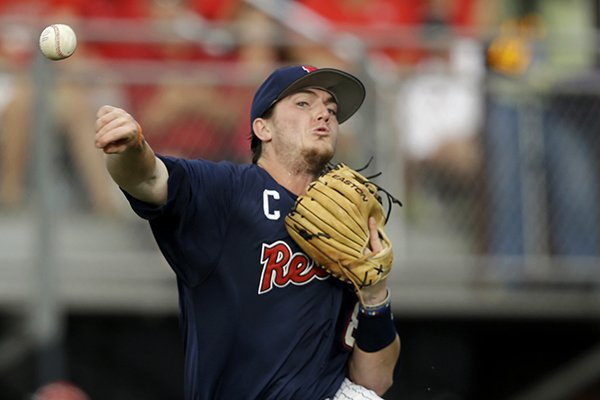 Mississippi infielder Austin Anderson throws out Louisiana Lafayette's Jace Conrad in the first inning of an NCAA college baseball tournament super regional game in Lafayette, La., Monday, June 9, 2014. (AP Photo/Gerald Herbert)