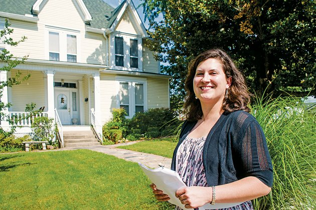 rachel-silva-with-the-arkansas-historic-preservation-program-pauses-in-front-of-the-gl-cunningham-house-that-will-be-part-of-the-walks-through-history-tour-of-the-moose-addition-historic-district-in-morrilton