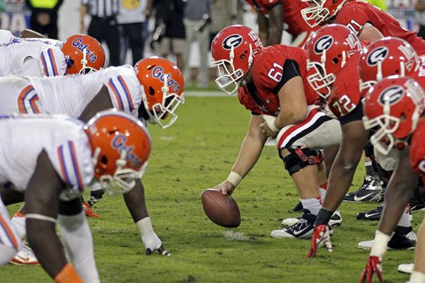 In this Oct. 27, 2012, file photo, The Florida defense, left, lines up for a play against Georgia during the second half of an NCAA college football game in Jacksonville, Fla. (AP Photo/John Raoux, File)