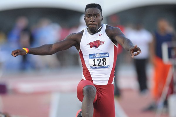 Arkansas freshman Clive Pullen competes in the triple jump during the third day of the NCAA Outdoor Track and Field West Preliminary Meet at John McDonnell Field in Fayetteville.