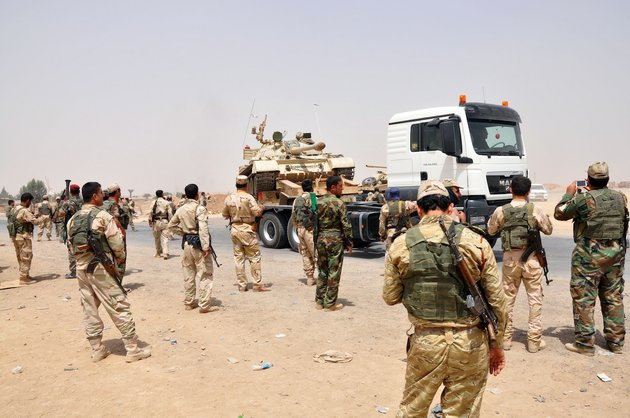 kurdish-security-forces-deploy-outside-of-the-oil-rich-city-of-kirkuk-180-miles-north-of-baghdad-on-thursday-june-12-2014-the-al-qaida-inspired-group-that-captured-two-key-sunni-dominated-cities-in-iraq-this-week-vowed-on-thursday-to-march-on-to-baghdad-raising-fears-about-the-shiite-led-governments-ability-to-slow-the-assault-following-the-insurgents-lightning-gains