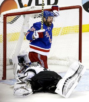 Martin St. Louis of the New York Rangers reacts after scoring a goal against Los Angeles Kings goalie Jonathan Quick on Wednesday night in Game 4 of the Stanley Cup final.