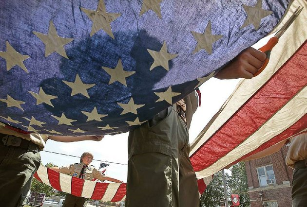 a-flag-retirement-ceremony-by-the-boy-scouts-and-girl-scouts-is-just-one-of-the-activities-at-arkansas-flag-and-banners-flag-day-celebration-on-saturday