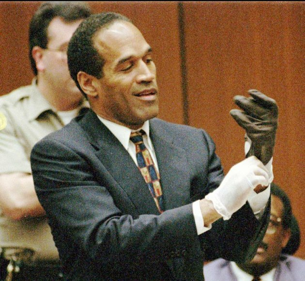 murder-defendant-oj-simpson-tries-on-one-of-the-leather-gloves-that-prosecutors-said-he-wore-the-night-of-the-murders-of-his-ex-wife-nicole-brown-simpson-and-ron-goldman-the-1995-trial-is-the-subject-of-a-new-special-on-cables-id-network