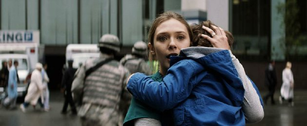 elizabeth-olsen-as-elle-brody-and-carson-bolde-as-sam-broday-in-godzilla