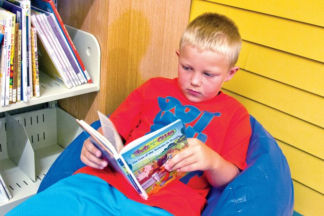 colby-boyd-7-relaxes-on-a-bean-bag-while-reading-in-the-new-mary-i-wold-cleburne-county-library-in-heber-springs-the-facility-opened-june-4-and-has-already-seen-checkouts-triple