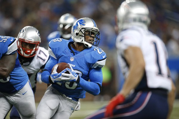 Detroit Lions cornerback Chris Houston (23) intercepts a New England Patriots quarterback Tom Brady pass for 11-yards in the second quarter of an NFL preseason football game in Detroit, Thursday, Aug. 22, 2013. (AP Photo/Rick Osentoski)