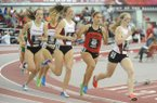 Arkansas' Jessica Kamilos, right, leads Georgia's Stella Christoforou (452) as Arkansas' Paige Johnson and Shannon Klenke trail Saturday, Jan. 26, 2013, while competing in the mile during the Razorback Invitational at the Randal Tyson Track Center in Fayetteville.