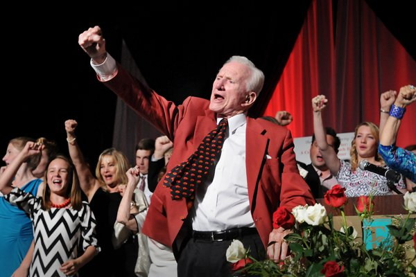 Frank Broyles, surrounded by his family, calls the hogs to close the evening during the 'Coach's Quarter: A Celebration of Coach Broyles' Life and Career' banquet at the John Q Hammons Center in Rogers on Saturday June 7, 2014.