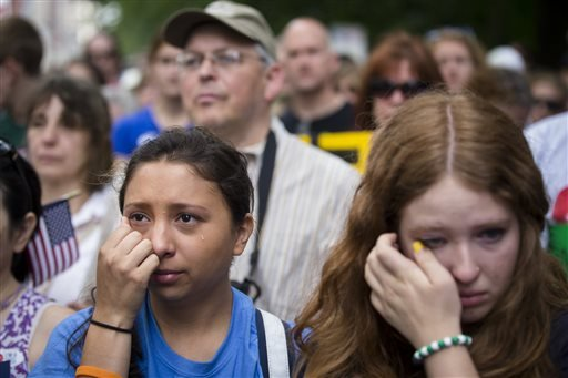 michelle-zarisis-of-newtown-conn-wipes-away-a-tear-at-a-rally-outside-city-hall-to-call-for-tougher-gun-control-laws-saturday-june-14-2014-in-new-york-the-protest-was-underwritten-by-former-new-york-mayor-michael-bloomberg-one-of-the-most-visible-gun-control-advocates-in-the-us-and-included-relatives-of-some-of-those-slain-in-the-2012-shooting-rampage-at-sandy-hook-elementary-school