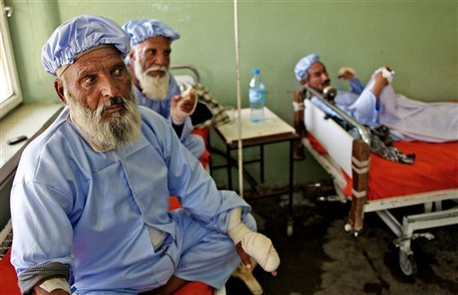 afghan-men-who-their-fingers-have-been-cut-off-by-taliban-fighters-as-a-punishment-for-voting-rest-in-a-hospital-in-herat-west-of-kabul-afghanistan-sunday-june-15-2014-a-roadside-bomb-killed-many-people-in-afghanistan-including-election-workers-and-the-taliban-cut-off-the-fingers-of-nearly-a-dozen-people-to-punish-them-for-voting-in-this-weekends-presidential-runoff-officials-said-sunday