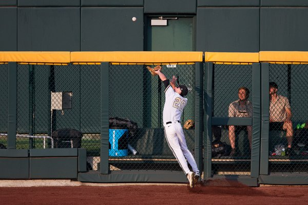 Vanderbilt left fielder Bryan Reynolds (20 ) catches a fly ball during the second inning against Louisville at the College World Series on Saturday, June 14, 2014, in Omaha, Neb. (AP Photo/Omaha World-Herald, Sarah Hoffman)