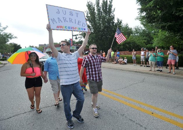 todd-walters-front-walks-saturday-with-his-domestic-partner-mike-emery-along-dickson-street-as-gay-rights-supporters-participate-in-the-annual-nwa-pride-parade-in-fayetteville