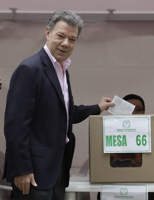 President Juan Manuel Santos casts his ballot during presidential elections in Bogota, Colombia, Sunday, June 15, 2014. Santos is seeking a second four-year term as candidate for the Social Party of National Unity.