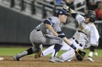 Vanderbilt's Dansby Swanson (7) steals second base against UC Irvine second baseman Grant Palmer (27), in the eighth inning of an NCAA baseball College World Series game in Omaha, Neb., Monday, June 16, 2014. (AP Photo/Eric Francis)