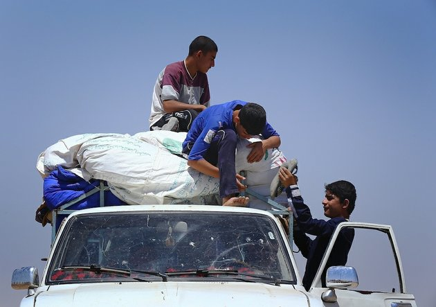 iraqis-who-have-fled-the-violence-in-their-hometown-of-mosul-unload-their-car-at-khazir-refugee-camp-outside-of-irbil-217-miles-north-of-baghdad-iraq-on-monday-june-16-2014