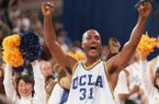 In this April 3, 1995, file photo, UCLA's Ed O'Bannon celebrates after his team won the NCAA championship game against Arkansas in Seattle. Five years after the former UCLA star filed his antitrust lawsuit against the NCAA, it goes to trial Monday, June 9, 2014, in a California courtroom. (AP Photo/Eric Draper, File)