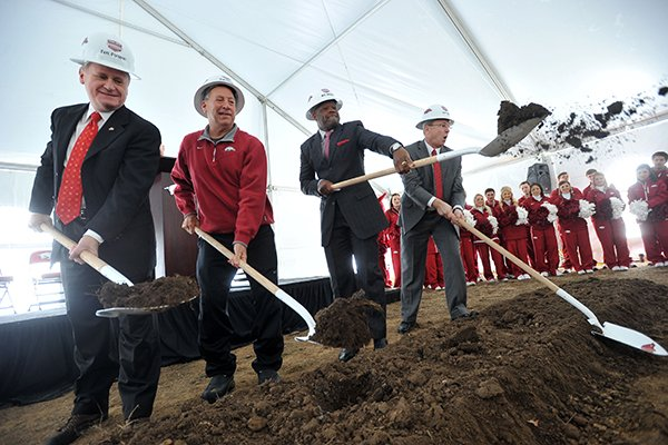 University of Arkansas chancellor G. David Gearhart, former women's head basketball coach Tom Collen, men's head basketball coach Mike Anderson and athletics director Jeff Long throw dirt during the official groundbreaking for the new Razorback Basketball Performance Center Saturday, Dec. 7, 2013 in Fayetteville. The 66,000 square foot facility is one of three new facilities for athletes being built on the campus, funded in part by financial donations to the Razorback Foundation.