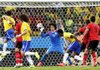 Mexican goalkeeper Guillermo Ochoa (13) bats away a header by Brazil's Fred (left) during a Group A match Tuesday in Fortaleza, Brazil. Ochoa stopped all eight Brazilian shots as the teams battled to a 0-0 tie.