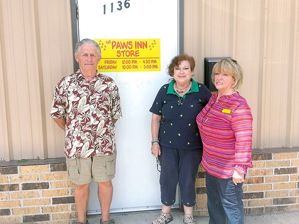 paws-inn-no-kill-animal-shelter-members-from-left-treasurer-tom-slough-vice-president-ruth-lacey-and-president-sandra-briggs-are-shown-at-their-new-location-where-they-have-more-space-for-the-organizations-mini-flea-market