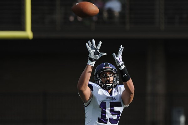 Fayetteville tight end C.J. O'Grady makes a catch during the annual spring Purple-White game Friday, May 30, 2014, at Harmon Stadium in Fayetteville.