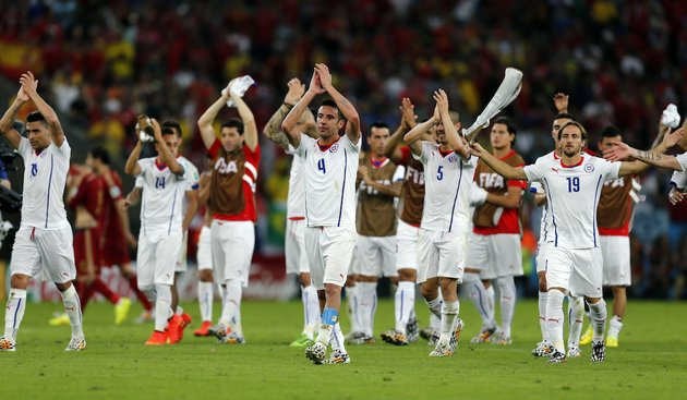 chiles-national-team-applaud-spectators-after-their-victory-over-spain-during-the-group-b-world-cup-soccer-match-between-spain-and-chile-at-the-maracana-stadium-in-rio-de-janeiro-brazil-wednesday-june-18-2014-defending-champion-spain-was-eliminated-from-the-world-cup-after-losing-to-chile-2-0