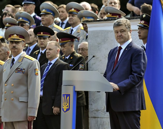 ukrainian-president-petro-poroshenko-right-attends-a-graduation-ceremony-at-the-ukrainian-military-academy-in-kiev-ukraine-wednesday-june-18-2014-the-ukrainian-president-on-wednesday-announced-a-plan-to-end-the-fighting-in-eastern-ukraine-promising-a-unilateral-cease-fire-after-discussions-with-the-russian-and-german-leaders-a-potential-major-development-to-bring-peace-to-the-country-at-left-is-acting-ukrainian-defense-minister-mykhailo-koval