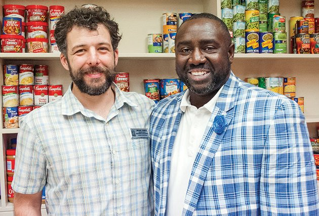 brian-james-left-and-marvin-williams-stand-by-shelves-in-the-bear-essentials-food-pantry-in-old-main-at-the-university-of-central-arkansas-in-conway