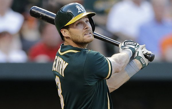 Oakland Athletics' Craig Gentry swings during a baseball game against the Baltimore Orioles, Friday, June 6, 2014, in Baltimore. (AP Photo/Patrick Semansky)