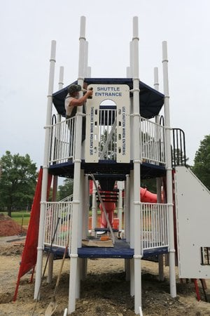 Skip Martin, with Ozark Mountain Installations in Missouri, works on the new Rocket Slide being built in Burns Park in North Little Rock on Thursday, June 5, 2014. The one being replaced was vandalized and set on fire Jan. 25.