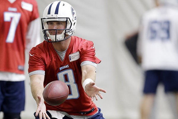 Tennessee Titans quarterback Tyler Wilson runs a drill during a NFL football minicamp on Monday, June 9, 2014, in Nashville, Tenn. (AP Photo/Mark Humphrey)