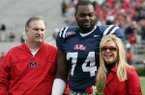Michael Oher, center, is pictured with adopted parents Sean and Leigh Anne Tuohy prior to an undated Ole Miss football game.