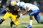 Dillard's Randy Ramsey (10) makes a tackle during a 2012 game against St. Thomas Aquinas in Fort Lauderdale, Fla.