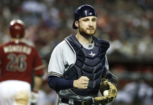 milwaukee-brewers-catcher-jonathan-lucroy-right-clutches-his-fist-after-arizona-diamondbacks-miguel-montero-26-strikes-out-to-end-the-inning-during-a-baseball-game-on-wednesday-june-18-2014-in-phoenix-the-diamondbacks-defeated-the-brewers-4-3-ap-photoralph-freso