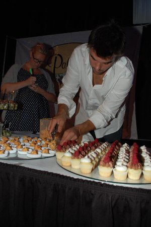 "Georges ""Georgie"" Launet, now head pizzaolo for Pizzeria Santa Lucia, prepares a catering tray for a 2012 benefit."