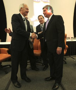 The two major party candidates for governor greet each other Thursday after speaking at the Arkansas Municipal League's convention in Little Rock. Republican nominee Asa Hutchinson (left) and Democratic nominee Mike Ross were joined by Little Rock Mayor Mark Stodola (center).
