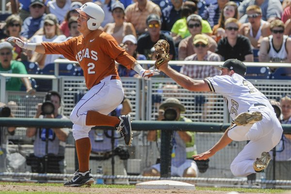 Texas' Mark Payton, left, is safe at first base after Texas pitcher Dillon Peters, right, stumbled and dropped the ball following the tag in the inning of an NCAA baseball College World Series game in Omaha, Neb., Friday, June 20, 2014. (AP Photo/Eric Francis)