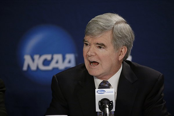 In this April 6, 2014, file phot, NCAA President Mark Emmert answers a question at a news conference in Arlington, Texas. Testifying in a landmark antitrust lawsuit filed against his organization, Emmert said Thursday, June 19, 2014, he believes there is a clear difference between the proposal to pay athletes a few thousand more dollars a year and giving them the equivalent of a salary. (AP Photo/David J. Phillip, File)