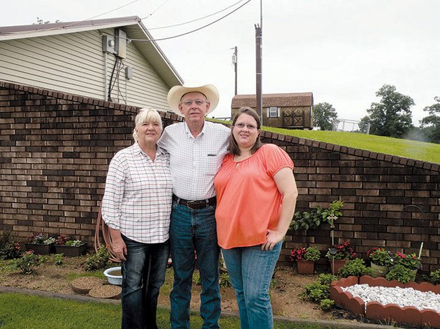 the-stan-garner-family-of-danville-has-been-named-2014-yell-county-farm-family-of-the-year-standing-in-front-of-their-earth-sheltered-home-are-from-left-betty-and-stan-garner-and-their-daughter-crystal-they-farm-160-acres-serving-as-contract-grazers-for-a-cowcalf-operation