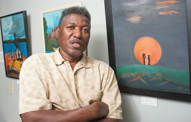 richard-brim-an-arkadelphia-native-stands-beside-some-of-his-paintings-that-are-currently-on-display-at-the-arkadelphia-art-center-farrell-ford-director-of-the-arts-center-noted-that-brims-works-have-drawn-attention-because-of-bold-colors-and-scenes-of-everyday-life-such-attributes-should-not-prove-a-surprise-because-brim-lists-norman-rockwell-a-noted-artist-who-captured-american-culture-as-his-biggest-art-influence