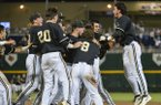 Vanderbilt players celebrate after a single by Tyler Campbell in the 10th inning scored Rhett Wiseman for a 4-3 win over Texas in an NCAA baseball College World Series game in Omaha, Neb., Saturday, June 21, 2014. Vanderbilt advances to the championship series. (AP Photo/Ted Kirk)