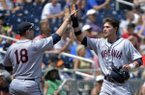 Virginia's Brandon Downes, right, celebrates with Nate Irving (18) after he scored against Mississippi on a two-run single by Robbie Coman in the fourth inning of an NCAA College World Series baseball game in Omaha, Neb., Saturday, June 21, 2014. (AP Photo/Ted Kirk)