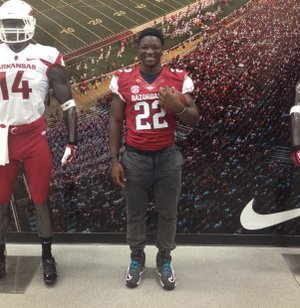 Arkansas running back commitment Rawleigh Williams sports a Hog jersey during his June visit.