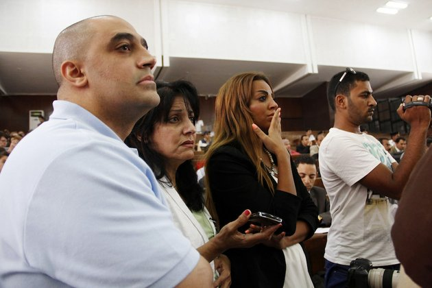 adel-fahmy-brother-of-mohamed-fahmy-left-wafa-bassiouni-mother-of-mohamed-fahmy-second-left-and-his-fiancee-third-left-watch-proceeding-during-the-sentencing-hearing-for-journalists-working-for-al-jazeera-in-a-courtroom-in-cairo-egypt-on-monday-june-23-2014-an-egyptian-court-on-monday-convicted-three-journalists-from-al-jazeera-english-and-sentenced-them-to-seven-years-in-prison-each-on-terrorism-related-charges