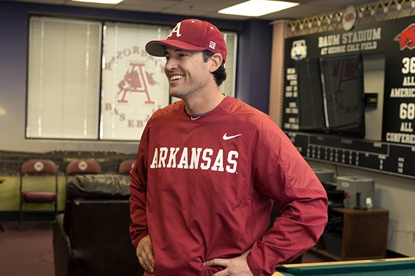 Tony Vitello, assistant coach for the Unviersity of Arkansas baseball team, talks with the media Friday, Feb. 7, 2014 at the University of Arkansas baseball media day at Baum Stadium in Fayetteville.