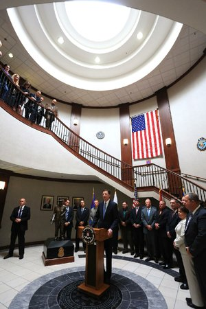 FBI Director James Comey, surrounded by law enforcement officers from around the state and agents at the Little Rock offices of the Federal Bureau of Investigation, talks Tuesday about terrorism and the threat it poses to the United States.