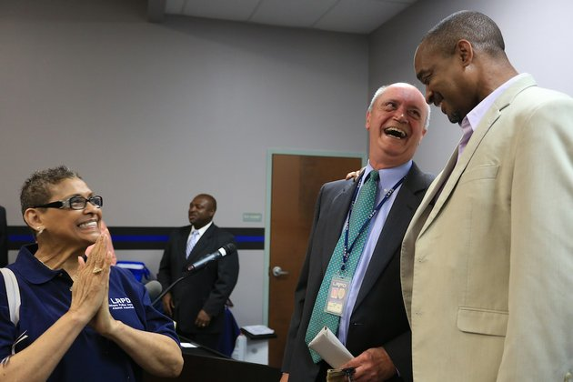 arkansas-democrat-gazetterick-mcfarland-062314-little-rock-police-chief-stuart-thomas-center-is-congratulated-by-ken-richardson-city-director-for-ward-2-at-a-retirement-ceremony-monday-for-thomas-at-the-little-rock-police-department-training-division-thomas-last-day-is-june-27-he-joined-the-department-in-1978-and-became-chief-in-2005