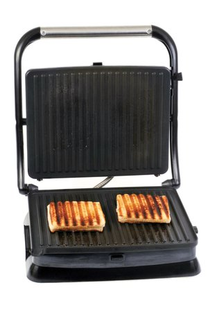 Cooks can use an inexpensive countertop electric panini maker or a hinged two-sided grill like this to make grilled chicken-breast panini.