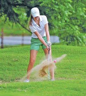 Staff Photo Michael Woods • @NWAMICHAELW Madde Weston chips out of a sand trap Thursday while competing in a youth golf tournament at Prairie Creek Country Club in Rogers. Weston is one of many youth volunteers for the LPGA golf tournament this week at Pinnacle Country Club in Rogers.